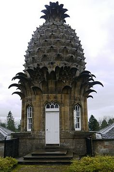 """Welcome to the Pineapple! Why did Lord Dunmore build this pineapple-shaped cottage in 1761 in the middle of Scotland?One blogger opines that pineapples were something of a status symbol, emblematic, perhaps, of abundance, prosperity & hospitality in the 18th century, imported by the wealthy from the Caribbean. @ Chatsworth, there are even greenhouses specially designed for growing pineapples. The same blogger noted """"The cottage is quite bijoux."""""""