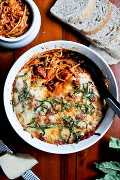 Topped with melted cheese and fresh basil, this recipe for Baked Parmesan Spaghetti is a delicious comfort food.