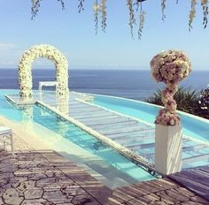 Summer weddings are always better with water! Walk down this isle and feel like an ocean princess! A princess also needs her ball gown. Call Bridal by Kotsovos at 513-791-3877