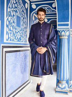 This navy blue sherwani with intricate tonal embroideries and silver buttons is the one you shouldn't miss. #Shaadisaga #groomswear #desicouture #indianweddingfashion #indianfashion #groom