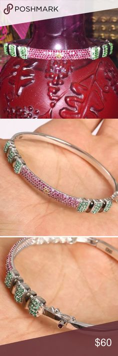 "💚TINY STONES of EMERALDS➕RUBIES BRACELET•925 SS💚 💗TINY CIRCLES of EMERALD ➕ RUBIES•925 STERLING SILVER BANGLE BRACELET • Material is .925 Sterling Silver. The stones are EMERALD & RUBY. This Bangle Bracelet is 7.59 grams. Head size is 0.27"". Inner diamater is 2.35"" Horizontally! .                                                       Safety Closure with a Ruby Accent! Has the 925 stamp. Made in EUROPE with high quality workmanship💗 Jewelry Bracelets"