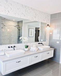 Shaker style cabinets in the bathroom are a must for a Hamptons home. Love how this one features black tapware and handles to make it feel… Hamptons Style Homes, Hamptons House, The Hamptons, Bathroom Styling, Bathroom Interior Design, Small Bathroom, Master Bathroom, Budget Bathroom, Modern Bathroom