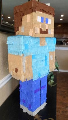 Minecraft Party Steve Pinata by UncleBucksPartyStuff on Etsy - can be easily made at home.  Very simple project!