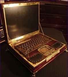 Datamancer's Steampunk Laptop. A fully functional HP laptop computer made of wood , copper and brass.