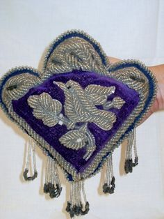 Antique Iroquois beaded velvet bird whimsy. Raised bead embroidery.