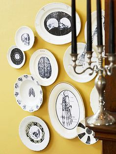 Anatomy Lesson | Print images of copyright-free clip art, then decoupage them onto inexpensive plates and bowls. Hang the serving pieces on the wall with removable, adhesive-backed, picture-hanging strips to avoid making nail holes for this seasonal display