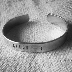 New Whovian bling in our Etsy shop! https://www.etsy.com/listing/223674703/allons-y-hand-stamped-dr-who-aluminum