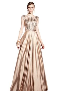 Long Sequins Gold Evening Dress (30530) £395.00 Make waves when you stride the red carpet in this amazing floor length sleeveless formal dress by Elliot Claire. A long vertical patterned prom gown with shimmering gold accents featuring a sparkling bodice with boat neckline and flowing A-line skirt. Sparkling gold sequins ring the waist for a sensational effect to this gold print evening gown.