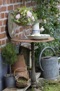 vignette of vintage garden corner.  Repinned by www.silver-and-grey.com
