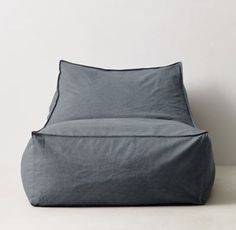 RH TEEN's Distressed Canvas Bean Bag Lounger - Blue:Version 2.0. Our relaxed lounger is a new take on the classic bean bag silhouette with its raised back and roomy seat. Covered in machine-washable canvas, it's filled with a body-conforming bead insert that cradles you in comfort.