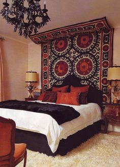 "i ike the idea of using a tapestry as a ""headboard""."