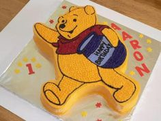 Winnie The Pooh Cake: Winnie the Pooh is flat surface. He has a honey pot in his hand while his other hand is up in the air, waving while walking.