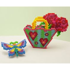 Create a beautiful basket of roses and a colorful butterfly with Perler beads! Makes a wonderful gift for Mother's Day, Valentine's Day, or a birthday.