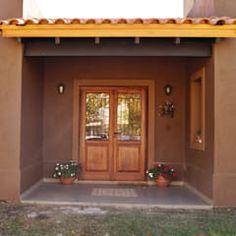 Hall de ingreso: Casas de estilo rústico por Abitar arquitectura