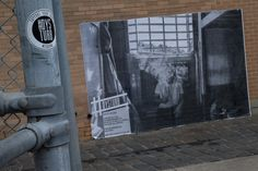 Support your local #Dysturb! Photo by Sebastien van Malleghem is pasted opposite #BodhiDharma in Balaclava. The caption reads: June 2011, Belgium. A prisoner tells the photographer about his birthplace in Morocco, while smoking a joint in his cell.  #Belgium #Morocco #photojournalism #Prison #Melbourne