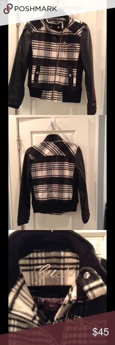 Guess black plaid jacket w/asymmetrical zipper Stay warm with the hottest trend, plaid!  This Guess jacket has faux leather sleeves, a slightly asymmetrical zipper and silver snaps.  Darling with a red scarf, black leggings and tall boots.  Very cozy feel, only worn 3-4 times.  You will adore how this jacket feels on! Guess Jackets & Coats Utility Jackets