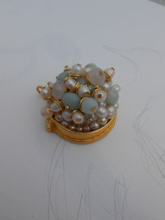 amazonite and fresh water pearls cluster in a gold pendant setting.