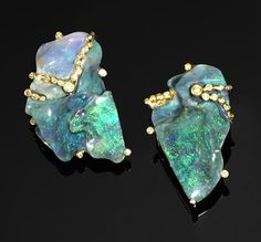 Lightning Ridge Opals: Of asymmetrical design, this pair of earrings incorporates a thick seam of black opal cut into two sections, weighing approximately carats, carats of brilliant-cut yellow diamonds Opal Earrings, Opal Jewelry, Chandelier Earrings, Jelly Opal, Black Opal, Black Diamond, Modern Jewelry, Asymmetrical Design, Asymmetrical Balance