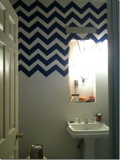 A chevron bathroom. So cute. Love how its just the top half of wall.