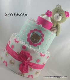 Listing is for this girl diaper cake with a teddy bear holding a diaper cupcake…