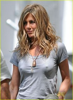 Jennifer Aniston - hair color?....this was the ORIGINAL caption for this picture...and all I could think was NIPPLES!!!! lmfao ~Erika