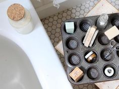 Repurpose a muffin pan in the bathroom as a handy tray for toiletries that you can bring by the tub for at-home pedicures, or place a few tea light candles inside to set a serene mood for a bath. Design by Kimberly Ludy Storage Hacks, Diy Storage, Storage Ideas, Bedside Storage, Makeup Storage, Garage Storage, Old Kitchen, Kitchen Items, Kitchen Stuff