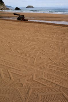 Stars printed in the sand by a tractor....A Sign in Space by Gunilla Klingberg