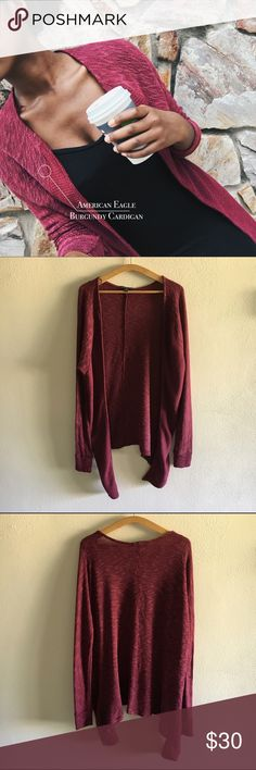 American Eagle Burgundy Cardigan Closet essential alert: nothing sales fall like a deep red sweater. This cardigan will keep you cute and cozy   Size large   Length: 27 inches   Back/Sleeves: 65% viscose, 30% polyester. Front Body: 61% viscose, 34% polyester   This product shows signs of normal wear and tear American Eagle Outfitters Sweaters Cardigans