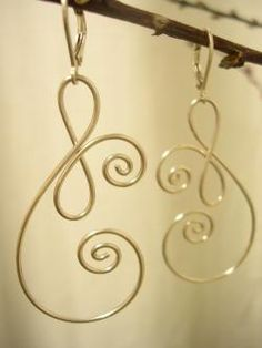 "Another original LilyGirl sterling wire earring. These measure approximately 2.5"" x 1"". Music-note-like!"
