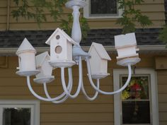 What does a stop at the Restore (Habitat for Humanity), 97 cent can of white spray paint and 5 dollar store wooden birdhouses make?  But a Birdhouse  Chandalier of course!!!