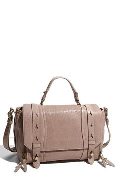 Olivia Harris 'Collar Stud - Small' Flap Satchel   Weathered lambskin leather gives a cool, vintage look to a strappy satchel topped with a handle and an optional adjustable strap. Side gussets unzip to slightly expand the silhouette, and antiqued zippers and collar studs continue the time-worn aesthetic.