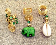This set includes 3 lovely loc jewelry pieces adorned with a cute elephant, brown & gold glass beads, & a cowrie shell. These are great for locs, twists, braids, or even loose natural hair! Please view the last photo to see our sizing chart. Measurements: The piece(s) photographed above are 7mm.  Drop us a msg if you have questions! :)