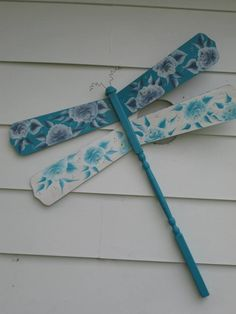 dragonfly made with ceiling fan blades. painted roses on the blades.