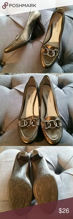 AK Anne Klein like new size 6.5 bronze heels Gorgeous Ann Klein bronze heels with silver hardware. No wear to shoe, even outsole. No scuffs, marks, or dings. Size 6.5. Like new condition. Genuine leather upper. Anne Klein Shoes Heels