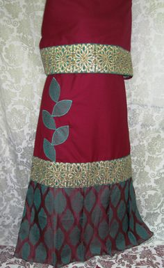 Royal maroon rida inspired from the 'Moghul Era' designed using pleated brocade panel at the base of the lehenga along with gold dori and machine work panel and appliques.  Flaunt this exclusive vintage look at INR 1850 only and make heads turn !