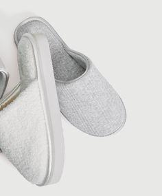 f501f1881620 Flatform slippers with satin trim detail