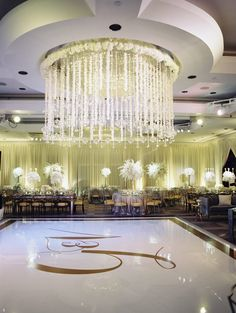 Crystal and white reception details and beautiful gold dance floor monogram - EVOKE | Abby Jiu Photography