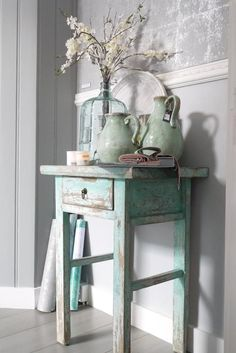 I love this blue painted side table with the gray walls