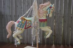 She is adorned with tattered tea stained lace, below a hand carved walnut finial. The base is reclaimed wood painted in white over pink, then lightly distressed Painted Pony, Hand Painted, Hand Carved, Merry Go Round Carousel, Carosel Horse, Decoupage, Painted Jewelry Boxes, Wooden Horse, Painting On Wood