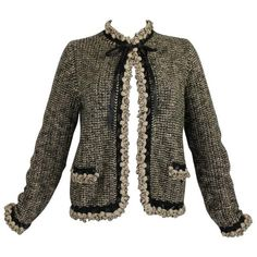 Preowned 1990s Chanel Wool And Camel Hair Cardigan With Braided... (2.505.995 COP) ❤ liked on Polyvore featuring tops, cardigans, brown, woven top, woven cardigan, brown cardigan, wool cardigan and chanel
