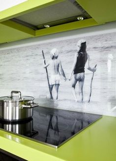 Blow up an old family picture and size to fit your kitchen wall.