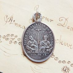 Confirmation Medal with St Peter and St Paul - Antique Reproduction by rosamystica on Etsy https://www.etsy.com/listing/225727811/confirmation-medal-with-st-peter-and-st