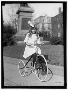 Girl and her tricycle London 1911