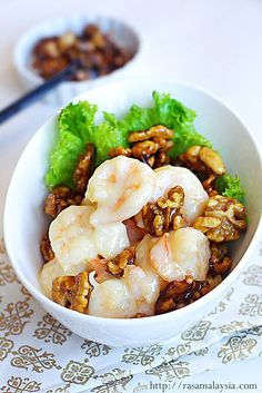 "This Honey Walnut Shrimp is loaded with all the right stuff: crunchy candy-glazed walnuts, big shrimp (which is referred to as ""prawn"" elsewhere), mayonnaise, condensed milk, and honey. With such mouthwatering ingredient lists, no wonder this is one of the most popular dishes in many Chinese restaurants."
