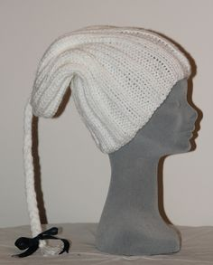 shivering sheep plait design with tartan bow.Hand knitted in many colours/