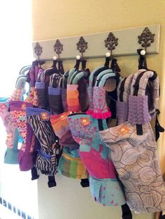 Baby carrier storage idea...because I have a slight addition and love affair with Tula...