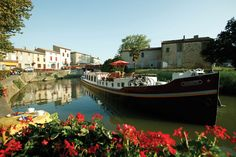 Skip the traditional Parisian vacation for a river cruise through France's most beautiful canals and countrysides aboard Belmond Afloat in France line. The cruise takes you along the less-touristy paths, showcasing the hidden travel treasures throughout France.