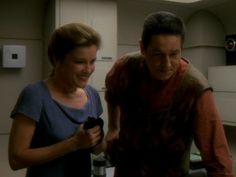 When I first saw this picture I immediately thought AWW THEYRE SMILING AND LOOKING AT THEIR LITTLE BABY! Aww Janeway and Chakotay :)!