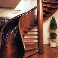 Not just a spiral stair, but a spiral with a slide. And not just a spiral/slide, but a gorgeous wood one?  Wow!