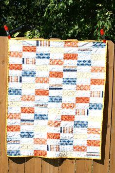 orange and blue boys quilt